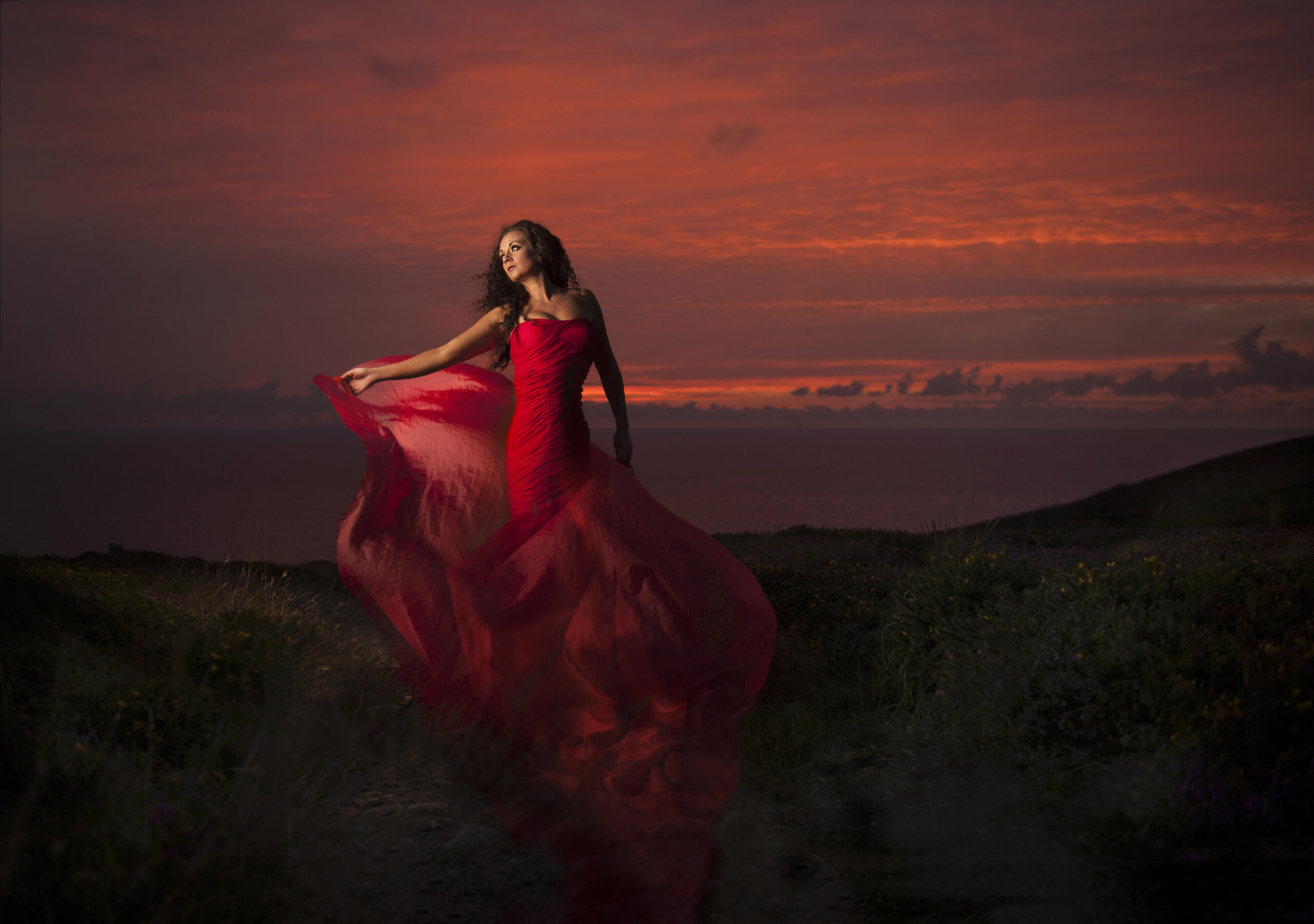 Kate in Red dress on location in cornwall in photography workshop