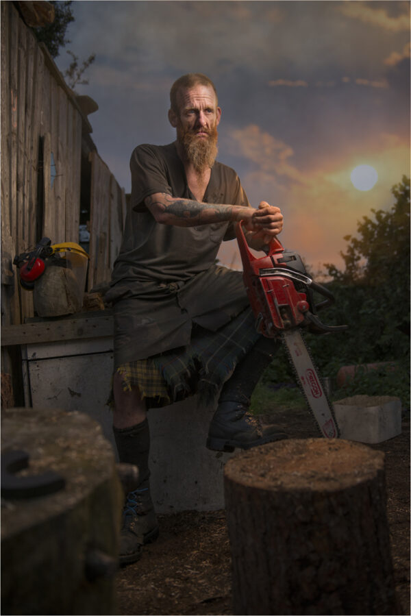 Portrait of man with chainsaw
